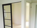 内装リフォーム白を基調としたスッキリきれいな洋室